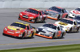 Nascar track with cars in foreground during race